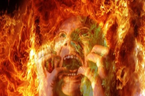 Person in agony in the fires of Hell