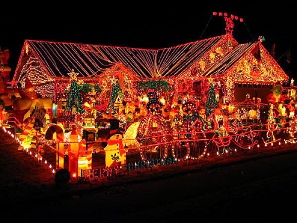House and yard covered in Christmas lights and decorations