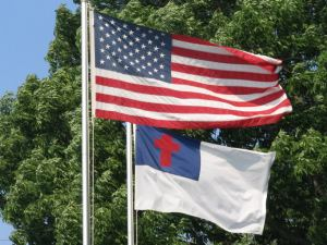 American and Christian flags flying