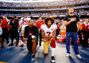 kaepernick-kneels-during-national-anthem-750
