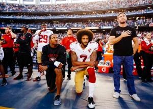 kaepernick-kneels-during-national-anthem-750